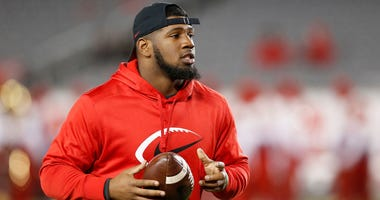 Ed Oliver #10 of the Houston Cougars watches players warm up before the game against the Tulane Green Wave at TDECU Stadium on November 15, 2018 in Houston, Texas.