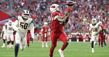 David Johnson #31 of the Arizona Cardinals catches a 32 yard touchdown pass from wide receiver Larry Fitzgerald #11 in the first half of the NFL game against the Los Angeles Rams at State Farm Stadium on December 23, 2018 in Glendale, Arizona.
