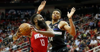 James Harden #13 of the Houston Rockets drives to the basket defended by Giannis Antetokounmpo #34 of the Milwaukee Bucks in the second half at Toyota Center on October 24, 2019 in Houston, Texas.