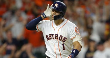 Carlos Correa #1 of the Houston Astros celebrates hitting a walk-off solo home run during the eleventh inning against the New York Yankees to win game two of the American League Championship Series 3-2 at Minute Maid Park on October 13, 2019 in Houston.