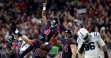 Nick Martin #66 of the Houston Texans lifts Deshaun Watson #4 in celebration after a fourth quarter touchdown pass against the Indianapolis Colts at NRG Stadium on November 21, 2019 in Houston, Texas.