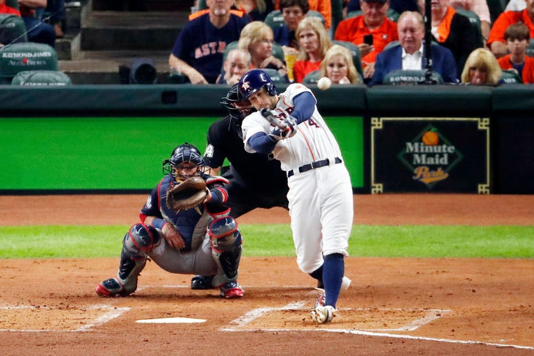 George Springer #4 of the Houston Astros hits a leadoff double against the Washington Nationals during the first inning in Game Six of the 2019 World Series at Minute Maid Park on October 29, 2019 in Houston, Texas.