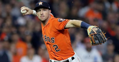 Alex Bregman #2 of the Houston Astros throws out Anthony Rendon (not pictured) of the Washington Nationals during the first inning in Game Seven of the 2019 World Series at Minute Maid Park on October 30, 2019 in Houston.