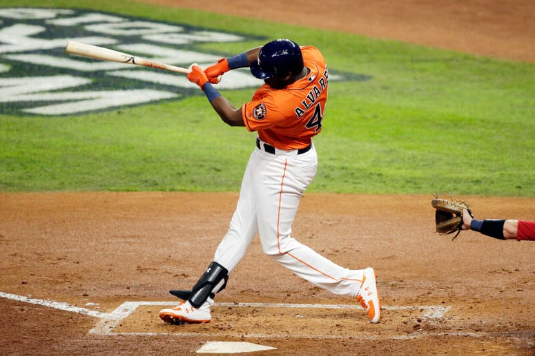 Yordan Alvarez #44 of the Houston Astros hits a single against the Washington Nationals during the second inning in Game Seven of the 2019 World Series at Minute Maid Park on October 30, 2019 in Houston, Texas.