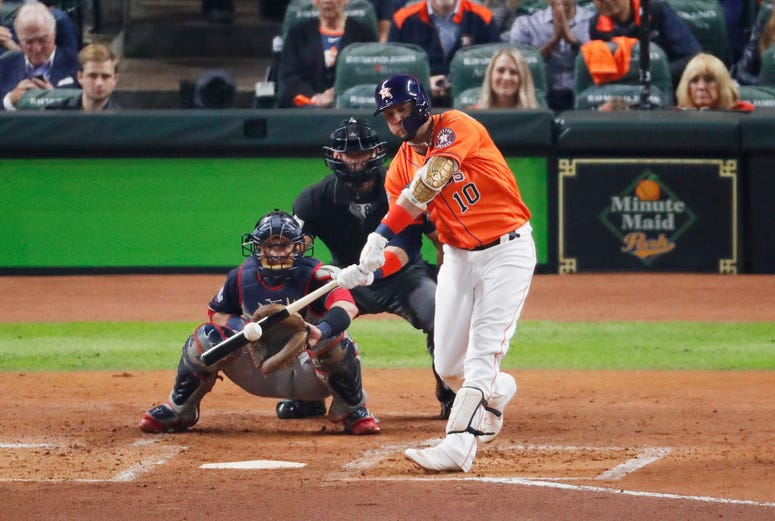 Yuli Gurriel #10 of the Houston Astros hits a solo home run against the Washington Nationals during the second inning in Game Seven of the 2019 World Series at Minute Maid Park on October 30, 2019 in Houston, Texas.