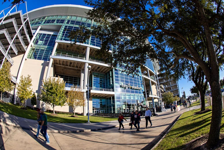 Exterior view of fans walking in past NRG Stadium before a game between the New England Patriots andf the Houston Texans at NRG Stadium on December 1, 2019 in Houston, Texas.