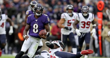 Lamar Jackson #8 of the Baltimore Ravens rushes for a first down in the third quarter against the Houston Texans at M&T Bank Stadium on November 17, 2019 in Baltimore, Maryland