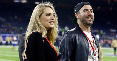 ustin Verlander and wife Kate Upton take in pre-game activities on the field before theHouston Texans play the Indianapolis Colts on Thursday Night Football at NRG Stadium on November 21, 2019 in Houston, Texas.
