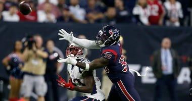Tashaun Gipson #39 of the Houston Texans breaks up a pass intended for Phillip Dorsett #13 of the New England Patriots during the fourth quarter at NRG Stadium on December 01, 2019 in Houston, Texas.