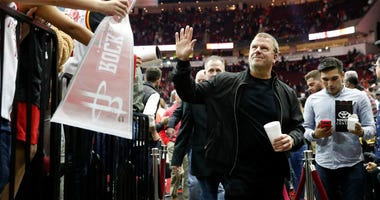 Owner Tilman Fertitta of the Houston Rockets waves to fans after the game against the Phoenix Suns at Toyota Center on December 7, 2019 in Houston, Texas.