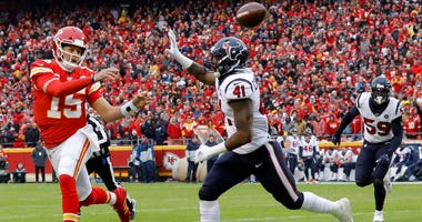 Quarterback Patrick Mahomes #15 of the Kansas City Chiefs delivers a pass over Zach Cunningham #41 of the Houston Texans during the AFC Divisional playoff game at Arrowhead Stadium on January 12, 2020 in Kansas City, Missouri.