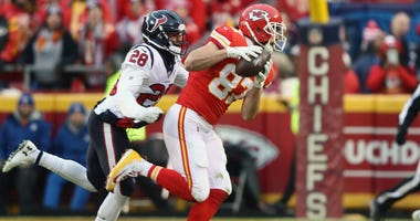 Travis Kelce #87 of the Kansas City Chiefs catches a pass while defended by Vernon Hargreaves III #28 of the Houston Texans during the second quarter in the AFC Divisional playoff game at Arrowhead Stadium on January 12, 2020 in Kansas City, Missouri.