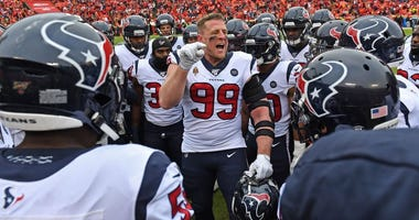 Defensive end J.J. Watt #99 of the Houston Texans talks with his teammates prior to the AFC Divisional playoff game against Kansas City Chiefs the at Arrowhead Stadium on January 12, 2020 in Kansas City, Missouri.