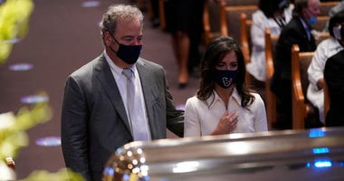 Cal McNair, chairman and chief executive officer of the Houston Texans, pauses at the casket bearing the remains of George Floyd in the chapel during his funeral service at the Fountain of Praise church June 9, 2020 in Houston, Texas.
