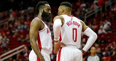 James Harden #13 of the Houston Rockets talks with Russell Westbrook #0 in the first half against the Orlando Magic at Toyota Center on March 08, 2020 in Houston, Texas.