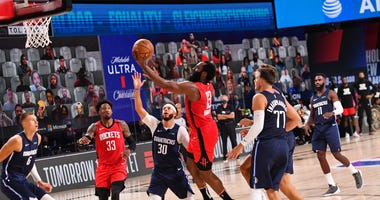 James Harden of the Houston Rockets shots the ball against the Dallas Mavericks on July 31, 2020 at The Arena at ESPN Wide World Of Sports Complex in Orlando, Florida.