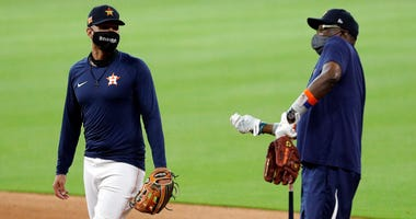 Yuli Gurriel #10 of the Houston Astros, left, and manager Dusty Baker wear masks during the third day of Summer Camp workouts at Minute Maid Park on July 05, 2020 in Houston, Texas.