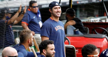 Justin Verlander #35 of the Houston Astros watches batting practice during Summer Workouts at Minute Maid Park on July 08, 2020 in Houston, Texas.