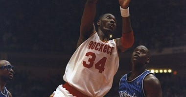 Center Hakeen Olajuwon of the Houston Rockets goes up for two during a Finals game against the Orlando Magic at The Summit in Houston, Texas. The Rockets won the game, 113-101.