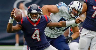 Deshaun Watson #4 of the Houston Texans rushes out of the pocket against the Tennessee Titans at NRG Stadium on October 1, 2017 in Houston, Texas. Houston won 57-14.