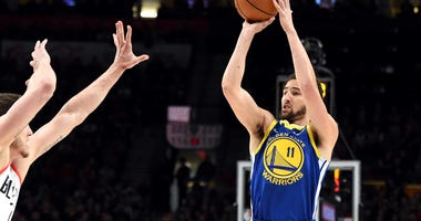 Klay Thompson of the Golden State Warriors shoots over the defense during the 2019 Western Conference finals.