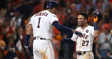 Houston Astros second baseman Jose Altuve (27) celebrates with shortstop Carlos Correa (1) after hitting a three-run home run against the Los Angeles Dodgers in the fifth inning in game five of the 2017 World Series at Minute Maid Park.
