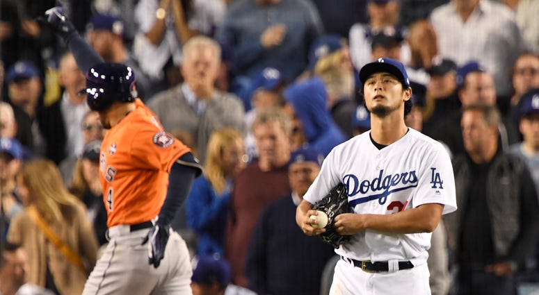 Los Angeles Dodgers starting pitcher Yu Darvish (21) reacts after a two run home run to Houston Astros center fielder George Springer (4) in the second inning in game seven of the 2017 World Series.