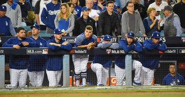 Los Angeles Dodgers players react from the dugout in the 9th inning against the Houston Astros in game seven of the 2017 World Series at Dodger Stadium.