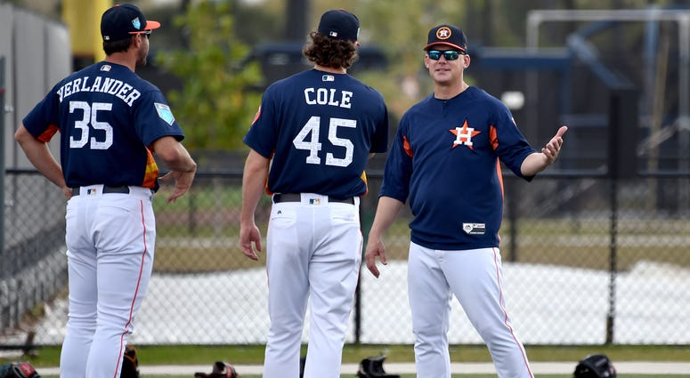 Houston Astros manager A.J. Hinch (right) laughs with Astros starting pitcher Gerrit Cole (center) and Astros starting pitcher Justin Verlander (left) prior to their workouts at The Ballparks of the Palm Beaches.