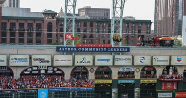 A 2017 world series banner is unveiled before a game between the Houston Astros and the Baltimore Orioles at Minute Maid Park.
