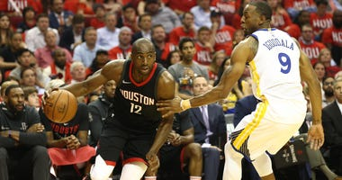 Houston Rockets forward Luc Mbah a Moute (12) drives against Golden State Warriors forward Andre Iguodala (9) during the second quarter in game one of the Western conference finals of the 2018 NBA Playoffs.