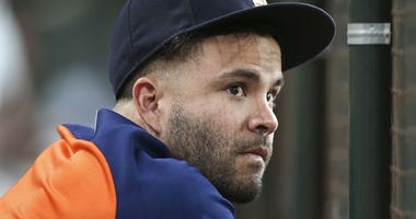 Jose Altuve watches from the bench