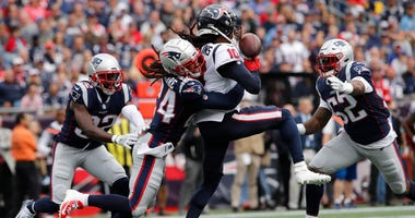 New England Patriots cornerback Stephon Gilmore (24) defends against Houston Texans wide receiver DeAndre Hopkins (10) in the second quarter at Gillette Stadium.