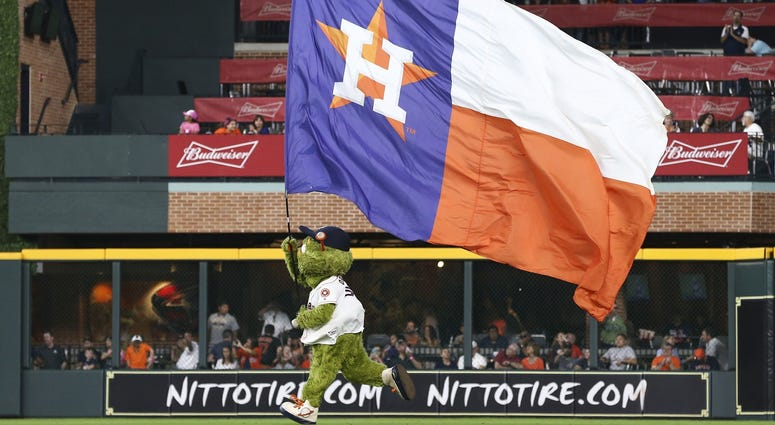 Orbit runs the Astros flag