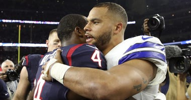 Dallas Cowboys quarterback Dak Prescott (4) and Houston Texans quarterback Deshaun Watson (4) hug after the game at NRG Stadium.