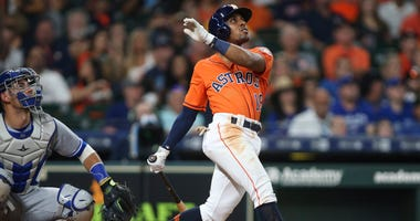 Houston Astros second baseman Tony Kemp (18) hits a home run against the Toronto Blue Jays during the third inning at Minute Maid Park.