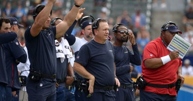 Houston Texans linebackers coach John Pagano (middle) looks on against the Los Angeles Chargers at Dignity Health Sports Park.