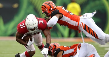 Arizona Cardinals running back David Johnson (31) tackled by Cincinnati Bengals middle linebacker Preston Brown (52) during the third quarter at Paul Brown Stadium.