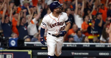 Houston Astros second baseman Jose Altuve (27) hits a 2-run walk off home run during the ninth inning against the New York Yankees in game six of the 2019 ALCS playoff baseball series at Minute Maid Park.