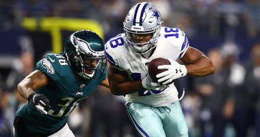 Dallas Cowboys receiver Randall Cobb (18) makes a catch down to the one yard line in the second quarter against Philadelphia Eagles cornerback Orlando Scandrick (38) at AT&T Stadium.