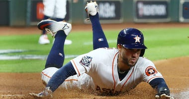 Houston Astros center fielder George Springer (4) scores a run against the Washington Nationals in the first second in game six of the 2019 World Series at Minute Maid Park.