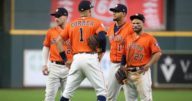 Houston Astros infielders Alex Bregman (2) , Carlos Correa (1), Yuli Gurriel (10) and Jose Altuve stand during a pitching change against the Washington Nationals during the eighth inning in game seven of the 2019 World Series at Minute Maid Park.