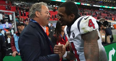 Houston Texans chief executive officer D. Cal McNair shakes hands with quarterback Deshaun Watson (4) after an NFL International Series game against the Jacksonville Jaguars at Wembley Stadium. The Texans defeated the Jaguars 26-3.