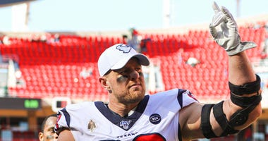 Houston Texans defensive end J.J. Watt (99) waves to fans after defeating the Kansas City Chiefs at Arrowhead Stadium.