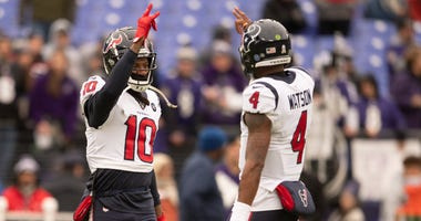 Houston Texans wide receiver DeAndre Hopkins (10) and quarterback Deshaun Watson (4) before the game against the Baltimore Ravens at M&T Bank Stadium.