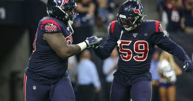 Houston Texans defensive end D.J. Reader (98) celebrates with outside linebacker Whitney Mercilus (59) after a play during the second quarter against the Indianapolis Colts at NRG Stadium.