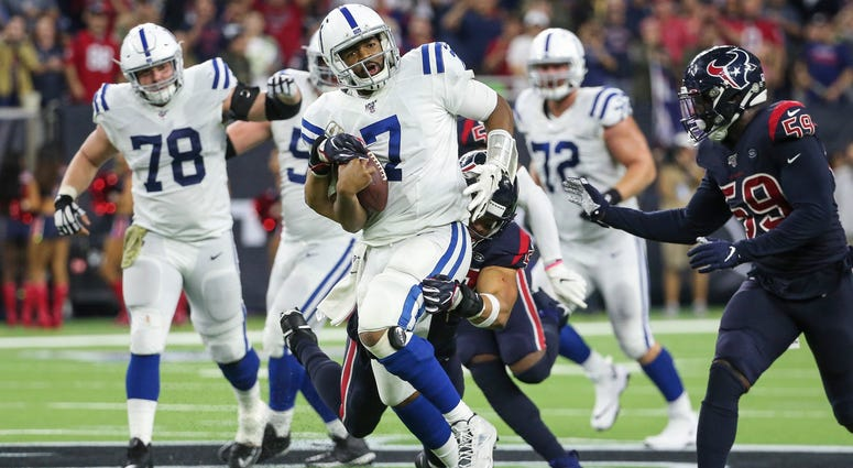 Texans outside linebacker Brennan Scarlett tackles Colts quarterback Jacoby Brissett