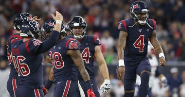 Houston Texans quarterback Deshaun Watson (4) celebrates throwing a touchdown pass against the New England Patriots in the second half at NRG Stadium.