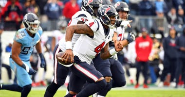 Houston Texans quarterback Deshaun Watson (4) runs for a short gain during the first half against the Tennessee Titans at Nissan Stadium.