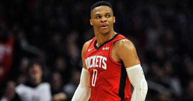 Houston Rockets guard Russell Westbrook (0) reacts after scoring a three point basket against the Los Angeles Clippers during the second half at Staples Center.